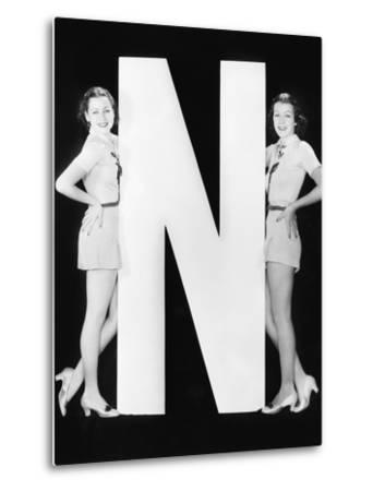 Two Women with Huge Letter N-Everett Collection-Metal Print