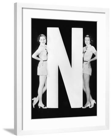 Two Women with Huge Letter N-Everett Collection-Framed Photographic Print