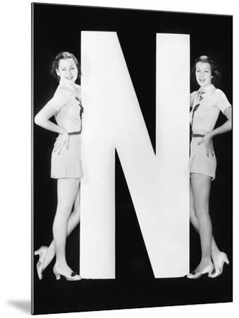 Two Women with Huge Letter N-Everett Collection-Mounted Photographic Print