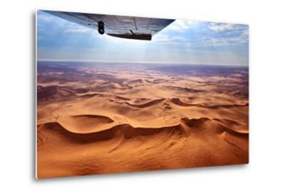 Beautiful Landscape of the Namib Desert under the Wing of the Aircraft at Sunset. Flying on a Plane-Oleg Znamenskiy-Metal Print