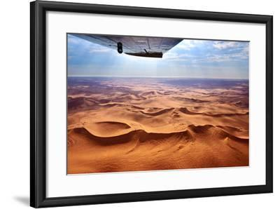 Beautiful Landscape of the Namib Desert under the Wing of the Aircraft at Sunset. Flying on a Plane-Oleg Znamenskiy-Framed Photographic Print