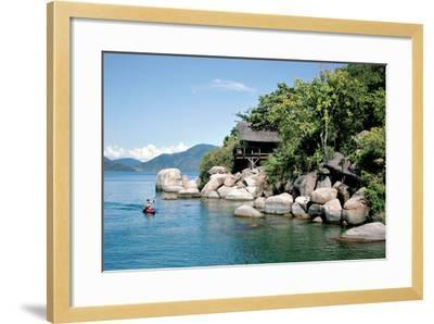 A Paddler Explores the Scenic Rock Formations of the Islands of Lake Malawi, Malawi, Africa, in His- SAPhotog-Framed Photographic Print