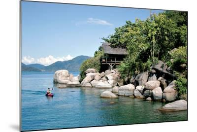 A Paddler Explores the Scenic Rock Formations of the Islands of Lake Malawi, Malawi, Africa, in His- SAPhotog-Mounted Photographic Print
