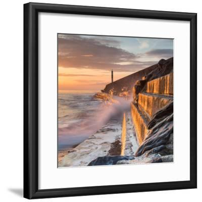 A Wave Rushes towards the Viewer along the Pier Wall at Sunset in Aberystwyth, West Wales, Uk. the-Izzy Standbridge-Framed Photographic Print