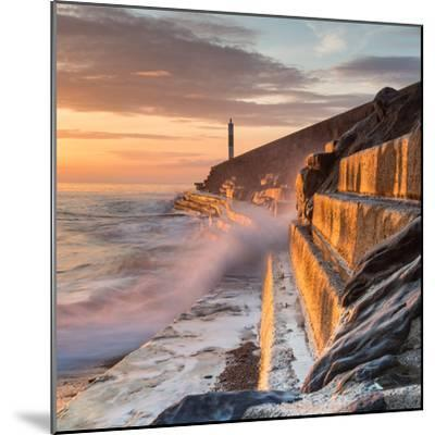 A Wave Rushes towards the Viewer along the Pier Wall at Sunset in Aberystwyth, West Wales, Uk. the-Izzy Standbridge-Mounted Photographic Print