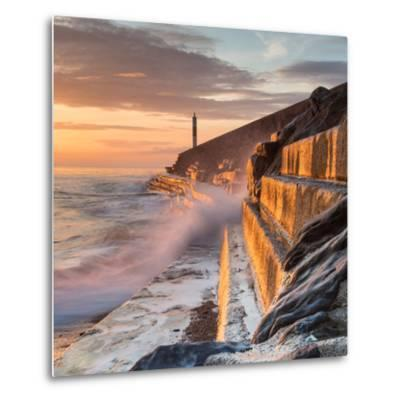 A Wave Rushes towards the Viewer along the Pier Wall at Sunset in Aberystwyth, West Wales, Uk. the-Izzy Standbridge-Metal Print