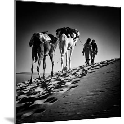 Square Black & White Image of 2 Men and 2 Camels in Sahara Desert-ABO PHOTOGRAPHY-Mounted Photographic Print
