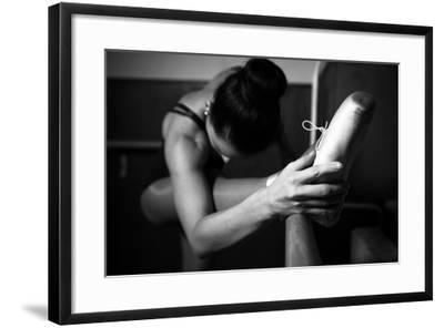 A Young Ballerina Practicing in the Hall, Black and White- momente-Framed Photographic Print