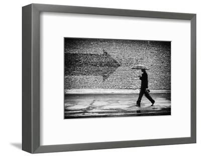 Wrong Way. A Man with Umbrella. Conceptual Image, Film Grain Added-Drop of Light-Framed Photographic Print