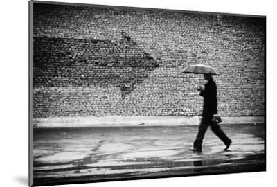 Wrong Way. A Man with Umbrella. Conceptual Image, Film Grain Added-Drop of Light-Mounted Photographic Print