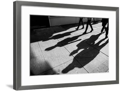 Shadows of Four Walking Pedestrians Projected on the Sidewalk- DrimaFilm-Framed Photographic Print