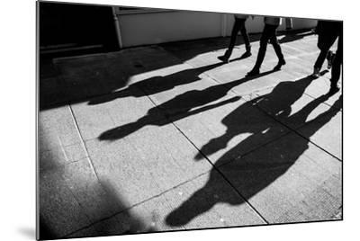 Shadows of Four Walking Pedestrians Projected on the Sidewalk- DrimaFilm-Mounted Photographic Print