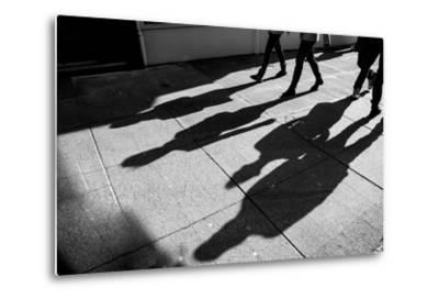 Shadows of Four Walking Pedestrians Projected on the Sidewalk- DrimaFilm-Metal Print