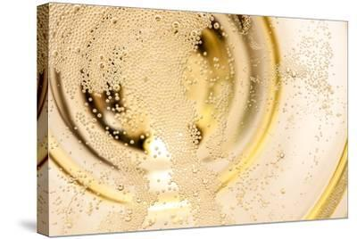 Many Tiny Bubbles in a Champagne Glass- unpict-Stretched Canvas Print