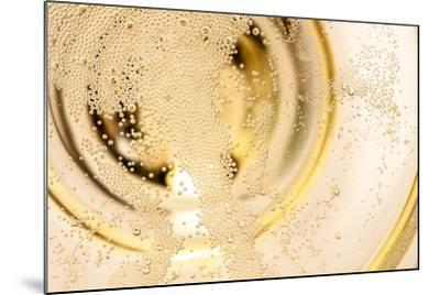 Many Tiny Bubbles in a Champagne Glass- unpict-Mounted Photographic Print