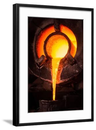 Steel Worker in Protective Clothing Raking Furnace in an Industrial Foundry- FreeProd33-Framed Photographic Print
