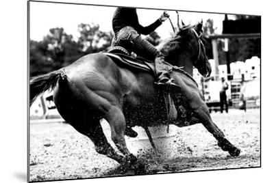 High Contrast, Black and White Closeup of a Rodeo Barrel Racer Making a Turn at One of the Barrels-Lincoln Rogers-Mounted Photographic Print