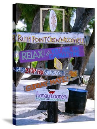 Fun Signpost at Run Point, Cayman Islands-George Oze-Stretched Canvas Print