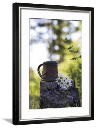 A Coffee Cup Sits In An Old Stump In The Woods Next To A Bouquet Of Daisies Summer In Montana-Hannah Dewey-Framed Photographic Print