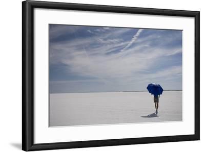 Man Walking With Blue Umbrella On The Bonneville Salt Flats-Lindsay Daniels-Framed Photographic Print