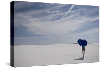 Man Walking With Blue Umbrella On The Bonneville Salt Flats-Lindsay Daniels-Stretched Canvas Print