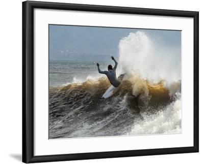 A Surfer Takes The Top Of A Wave In Santa Barbara, Ca-Daniel Kuras-Framed Photographic Print