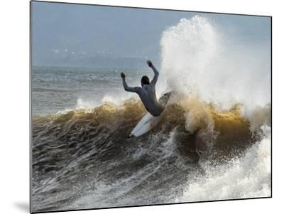 A Surfer Takes The Top Of A Wave In Santa Barbara, Ca-Daniel Kuras-Mounted Photographic Print
