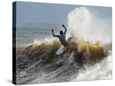A Surfer Takes The Top Of A Wave In Santa Barbara, Ca-Daniel Kuras-Stretched Canvas Print