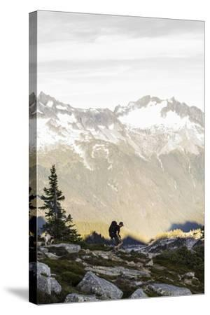 Lone Man Backpacks Down A Ridge In The North Cascades To His Camp-Site In Washington-Hannah Dewey-Stretched Canvas Print