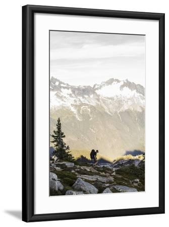 Lone Man Backpacks Down A Ridge In The North Cascades To His Camp-Site In Washington-Hannah Dewey-Framed Photographic Print