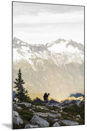Lone Man Backpacks Down A Ridge In The North Cascades To His Camp-Site In Washington-Hannah Dewey-Mounted Photographic Print