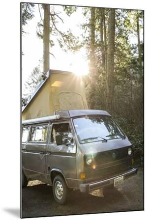 A Dog Peaks His Head Out In The Morning From A Volkswagen Bus On The Washington Coast-Hannah Dewey-Mounted Photographic Print