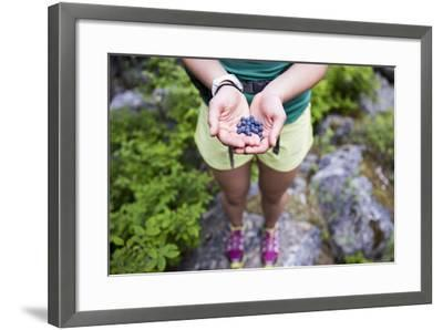 Woman Holds Out Wild Huckleberries She Picked While Hiking-Hannah Dewey-Framed Photographic Print