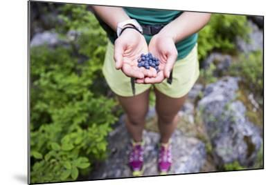 Woman Holds Out Wild Huckleberries She Picked While Hiking-Hannah Dewey-Mounted Photographic Print