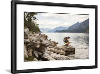 Woman Hangs Out On The Shore Of A Lake In British Columbia In Valhalla National Park, Bc-Hannah Dewey-Framed Photographic Print