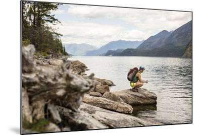 Woman Hangs Out On The Shore Of A Lake In British Columbia In Valhalla National Park, Bc-Hannah Dewey-Mounted Photographic Print