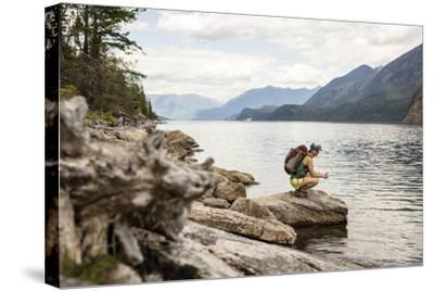 Woman Hangs Out On The Shore Of A Lake In British Columbia In Valhalla National Park, Bc-Hannah Dewey-Stretched Canvas Print