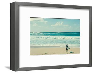 Surfer standing on the beach, North Shore, Oahu, Hawaii, USA--Framed Photographic Print