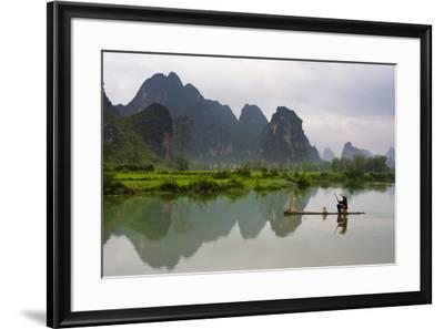 Fisherman on bamboo raft on Mingshi River at sunset, Mingshi, Guangxi Province, China-Keren Su-Framed Photographic Print