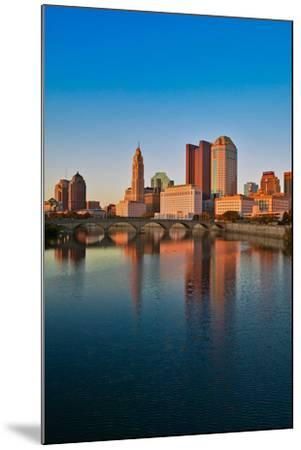 Scioto River and Columbus Ohio skyline in autumn with sunset reflection in water--Mounted Photographic Print