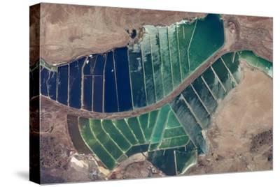 Satellite view of salt evaporation ponds in Jordan-Israel border--Stretched Canvas Print
