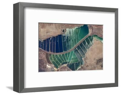 Satellite view of salt evaporation ponds in Jordan-Israel border--Framed Photographic Print