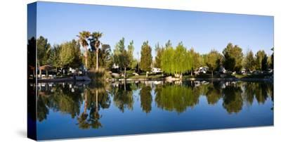 Terrible's Lakeside Casino RV Park reflected in lake in Pahrump, Nye County, Nevada, USA--Stretched Canvas Print