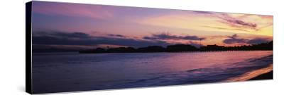 Silhouette of pier in pacific ocean, Santa Barbara, California, USA--Stretched Canvas Print