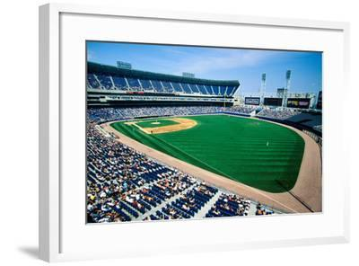 Long view of Baseball diamond and bleachers during professional Baseball Game, Comiskey Park, Il...--Framed Photographic Print