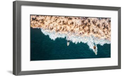Aerial drone photo of surfers riding Pacific Ocean waves in San Diego, California at Sunset Cliffs-David Chang-Framed Photographic Print