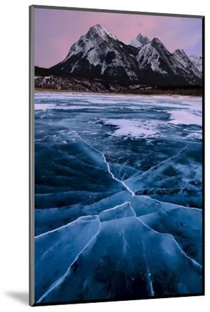 Ice cracks along Abraham Lake in Banff, Canada with purple clouds and scenic mountains-David Chang-Mounted Photographic Print