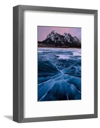 Ice cracks along Abraham Lake in Banff, Canada with purple clouds and scenic mountains-David Chang-Framed Premium Photographic Print