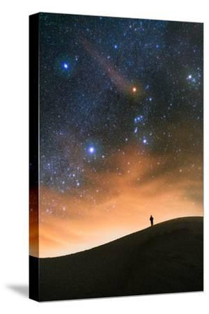 Colorful stars sky in White Sands Monument over Sand Dunes with silhouette and horizon air glow-David Chang-Stretched Canvas Print