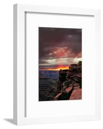 Red sunset with moody clouds and red rock canyons in Dead Horse Point State Park near Moab, Utah-David Chang-Framed Premium Photographic Print